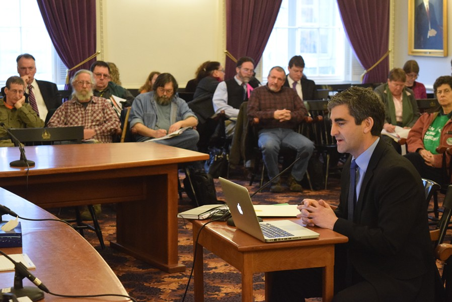 Burlington Mayor Miro Weinberger speaks at the Statehouse, as gun-rights activists look on. - TERRI HALLENBECK