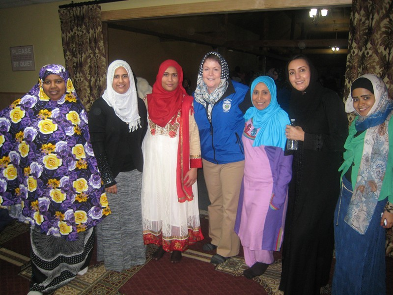 Jennifer Morrison, chief of the Colchester police department (center), with members of the Islamic Society of Vermont - KYMELYA SARI