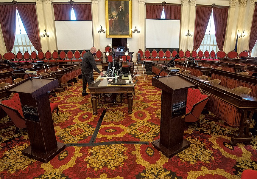 State Curator David Schutz checking on the layout of the House chamber - JEB WALLACE-BRODEUR