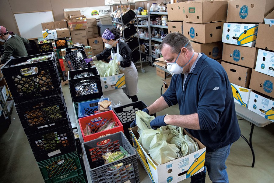 Packing food at Feeding Chittenden in April - FILE: JAMES BUCK