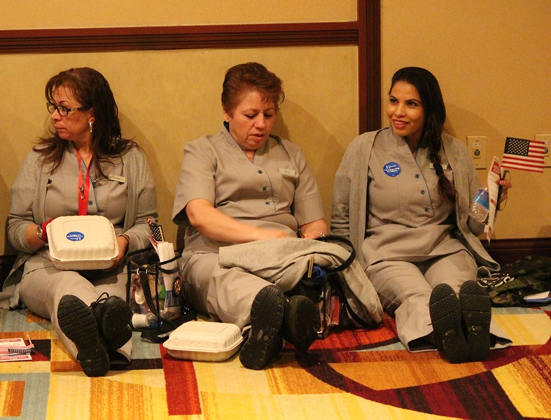 Casino workers wait for the Nevada caucuses to start Saturday at the New York-New York. - PAUL HEINTZ