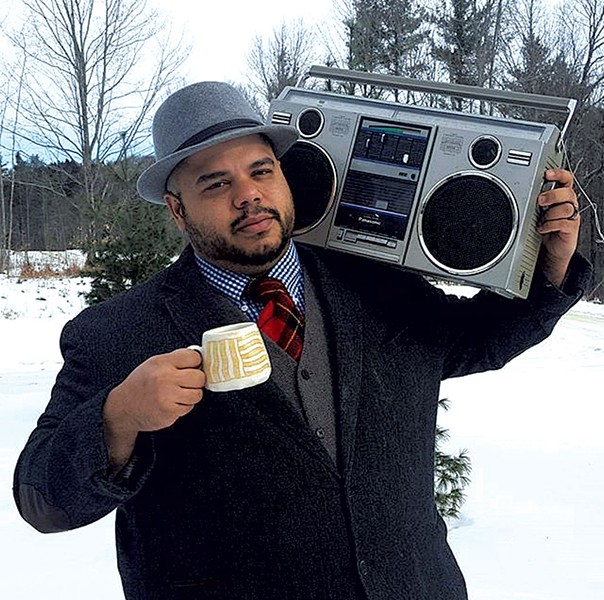 Roberto Lugo holding a Margaret Kinkeade cup - COURTESY OF ROBERTO LUGO