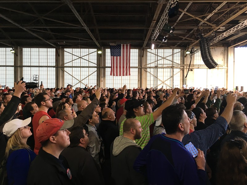 Trump supporters watch their candidate's plane pull up to a hangar at Youngstown-Warren Regional Airport Monday in Ohio. - PAUL HEINTZ