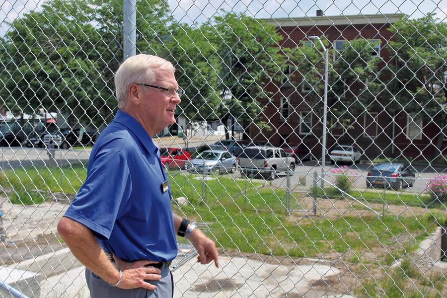 Bill Stenger surveys the Newport Renaissance Block site. - PAUL HEINTZ