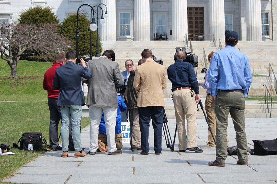 Reporters cover a press conference held by gubernatorial candidate Peter Galbraith Monday outside the Vermont Statehouse. - PAUL HEINTZ
