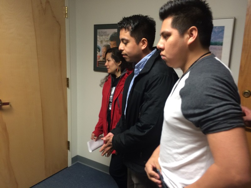 From left, Migrant Justice organizers Marita Canedo, Abel Luna and Enrique Balcazar wait to speak with a Leahy staffer. - ALICIA FREESE