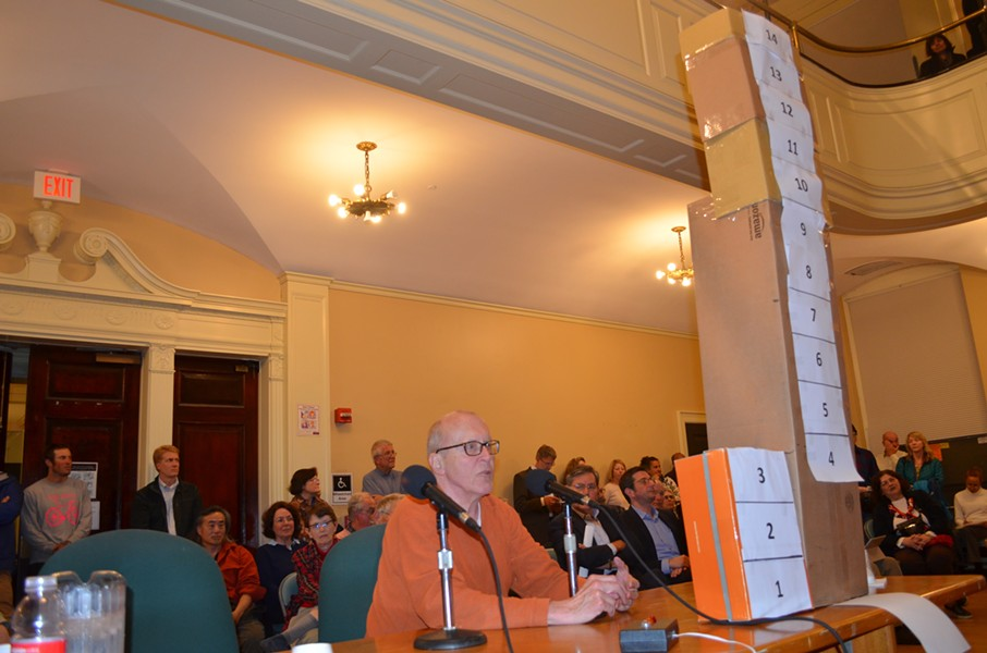Resident Jay Vos brought a cardboard model to the council meeting to show the scale of the proposed Burlington Town Center project.