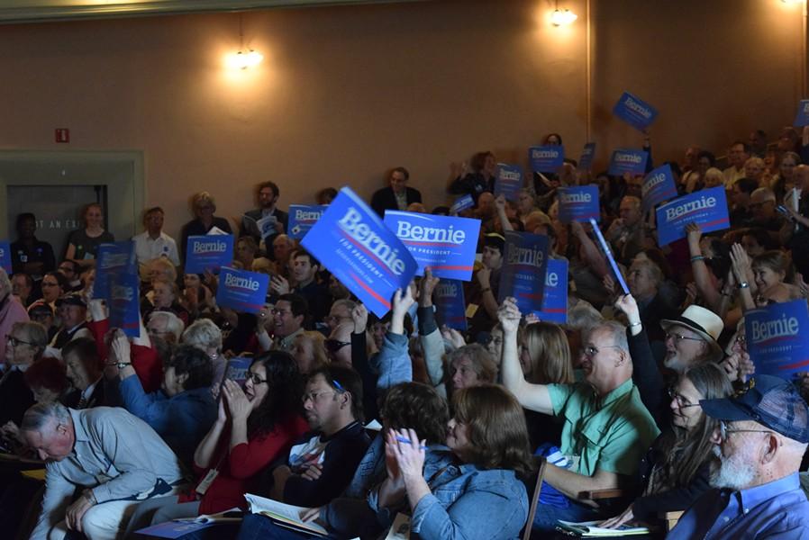 Vermont Democratic state convention delegates wave Bernie Sanders placards. - TERRI HALLENBECK