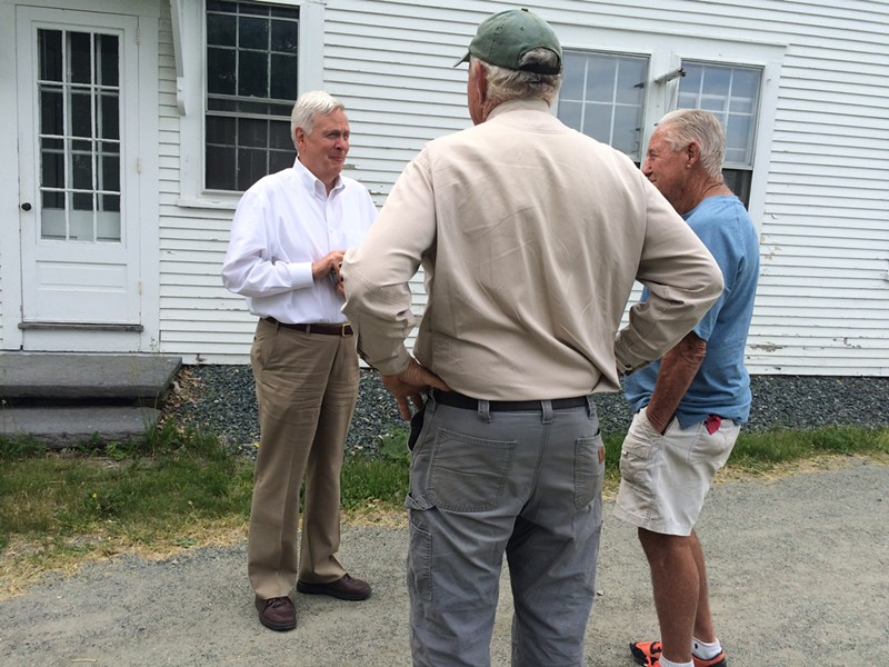 David Hall, left, chats with Bill Emmons, center, after meeting with members of the Two Rivers-Ottauquechee Regional Commission. - ALICIA FREESE