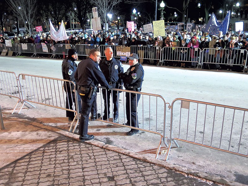 Brandon del Pozo with officers outside of the Flynn Center for the Performing Arts during Donald Trump's rally in January 2016