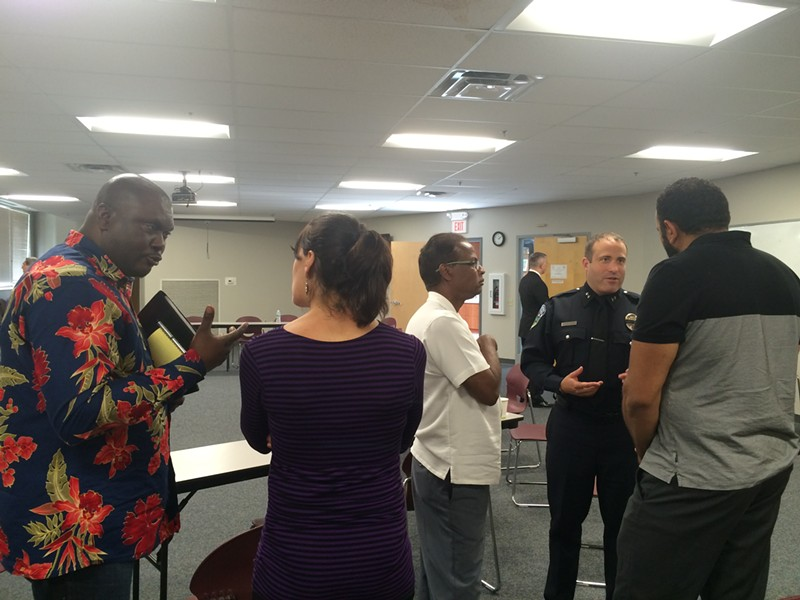 Cléophace Mukeba, left, talks about diversifying the BPD ranks, while Chief Brandon del Pozo chats with Farhad Khan and Imam Islam of the Islamic Society of Vermont. - ALICIA FREESE