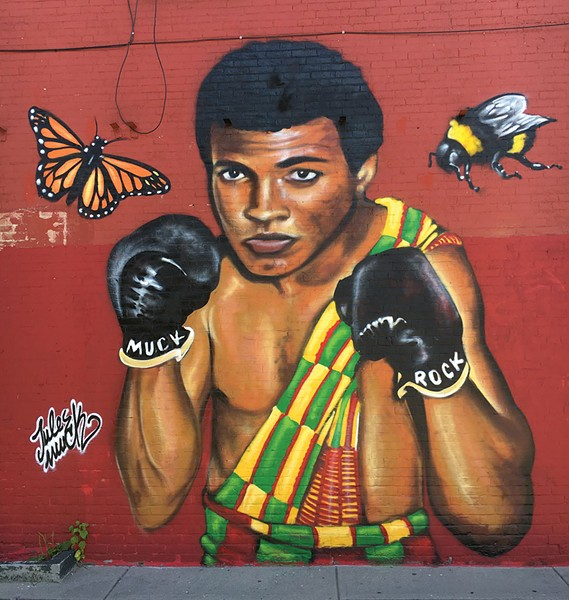 The Muhammad Ali mural at the Mawuhi African Market - MATTHEW ROY