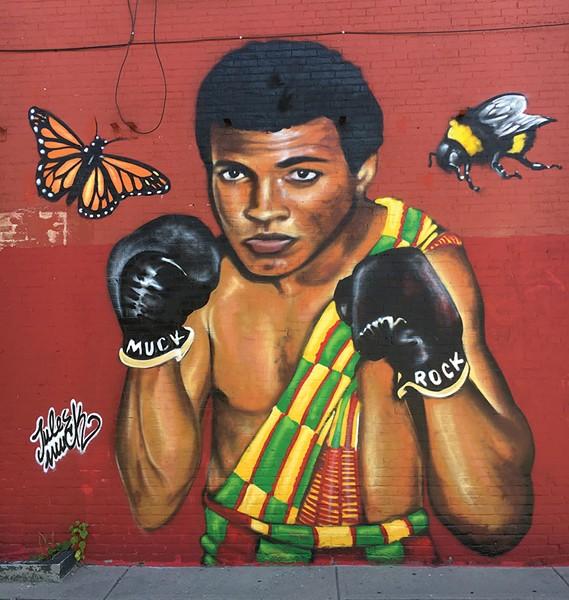 The Muhammad Ali mural at the Mawuhi African Market - MATTHEW ROY