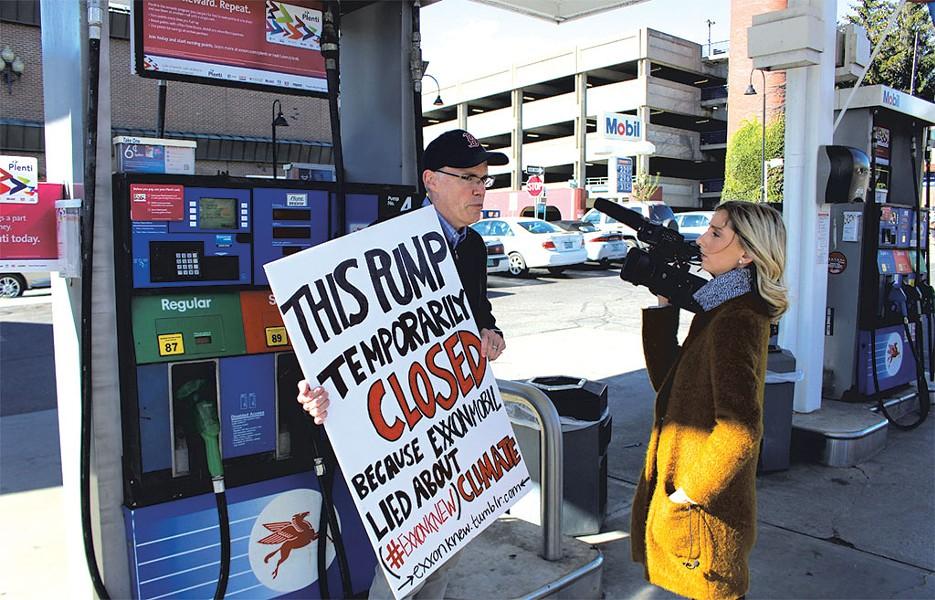 Bill McKibben protesting at Handy's Mobil in Burlington - FILE: PAUL HEINTZ