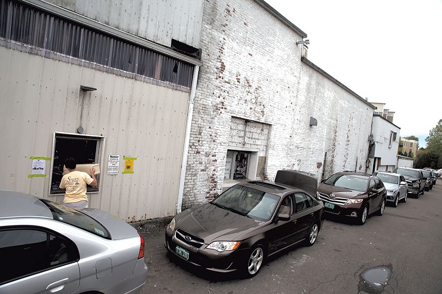 The line at the redemption center at Winooski's Beverage Warehouse - MATTHEW THORSEN