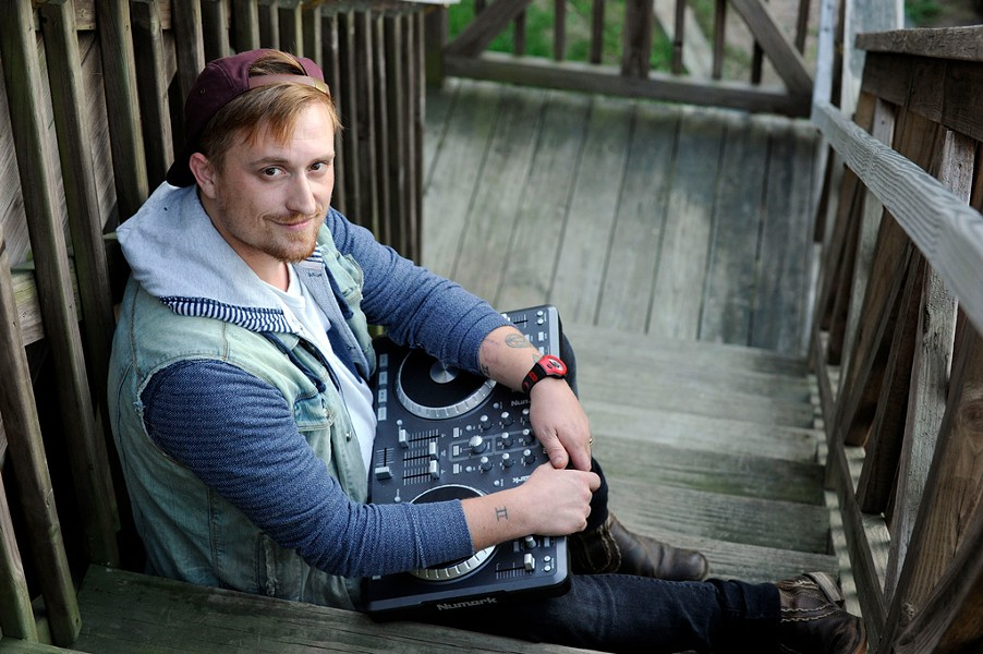 Musician Julian DeFelice, of Orange Julians, with his digital DJ controller at his home in Stowe - JEB WALLACE-BRODEUR
