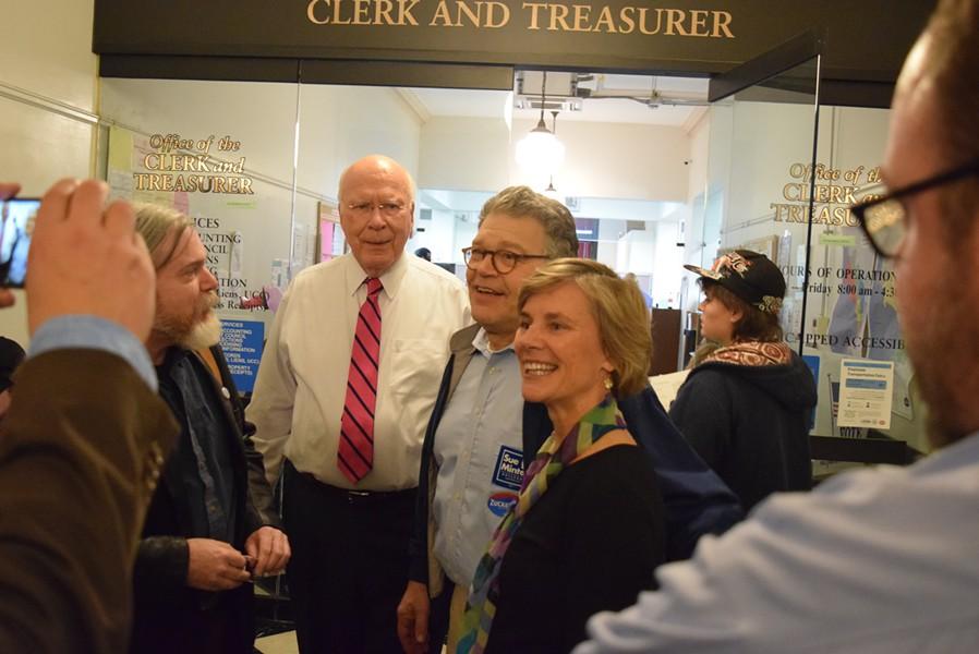 Sens. Patrick Leahy (D-Vt.) and Al Franken (D-Minn.) with Democratic gubernatorial candidate Sue Minter at the Burlington City Clerk's Office on Wednesday alongside voters casting their ballots - TERRI HALLENBECK/SEVEN DAYS