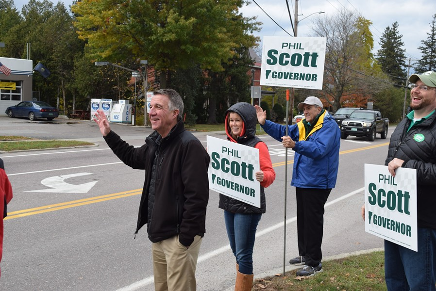 Republican gubernatorial candidate Phil Scott greets passersby in Shelburne with campaign coordinator Brittney Wilson,  Sen. Dick Mazza (D-Grand Isle) and campaign adviser Jason Gibbs. - TERRI HALLENBECK/SEVEN DAYS