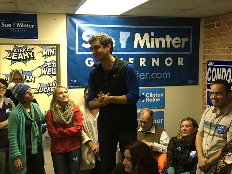 Sue Minter, left, looks on as Burlington Mayor Miro Weinberger addresses volunteers at the Vermont Democratic Party's Burlington office. - PAUL HEINTZ