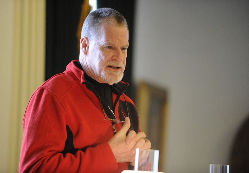 Tom Harty sporting his red fleece during the invocation. - JEB WALLACE-BRODEUR