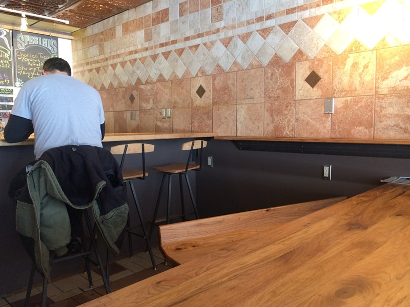 Tables and tiles at the Montpelier Mad Taco - SUZANNE PODHAIZER