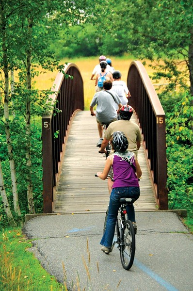 Biking the Stowe Recreation Path - FILE: JEB WALLACE-BRODEUR