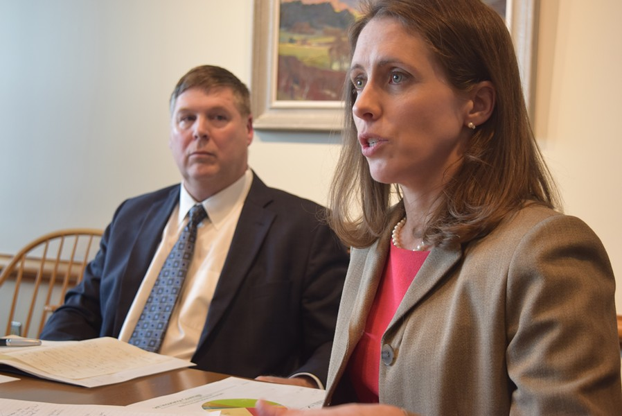 Mary Kate Mohlman, state director of health care reform, and Al Gobeille, secretary of the Agency of Human Services, talk to reporters Friday. - TERRI HALLENBECK