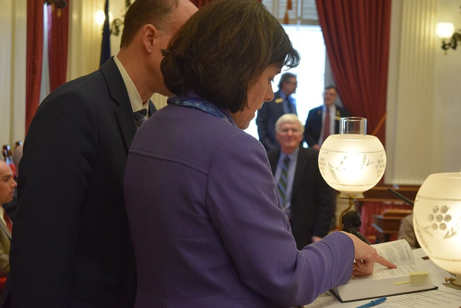 House Speaker Mitzi Johnson (D-South Hero) confers with House Clerk Bill Magill on procedural rules. - TERRI HALLENBECK