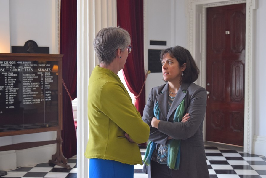 House Speaker Mitzi Johnson confers with Rep. Mary Hooper in the Statehouse hall. - TERRI HALLENBECK