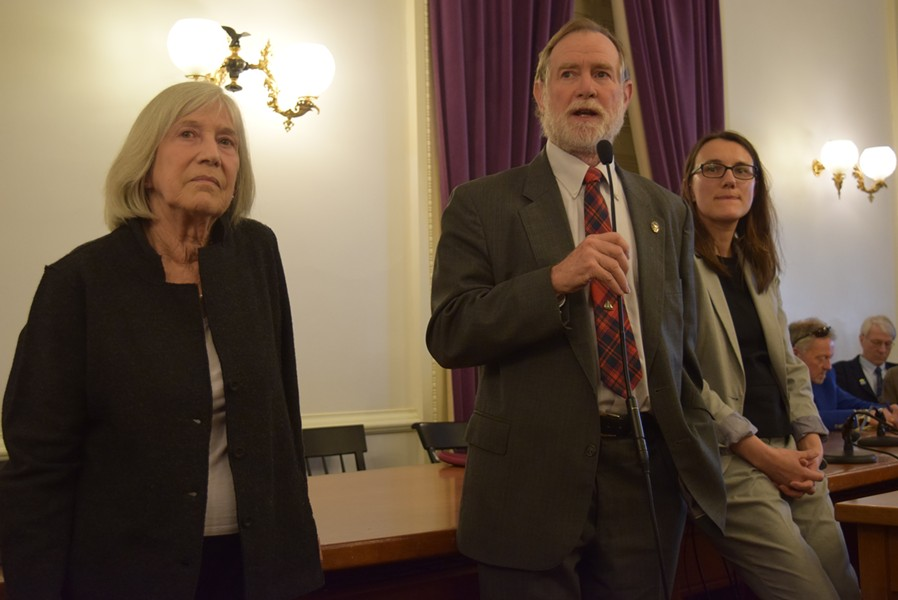 Rep. Dave Sharpe addresses the Democratic caucus Thursday as Rep. Janet Ancel, left, and Rep. Jill Krowinski look on. - TERRI HALLENBECK