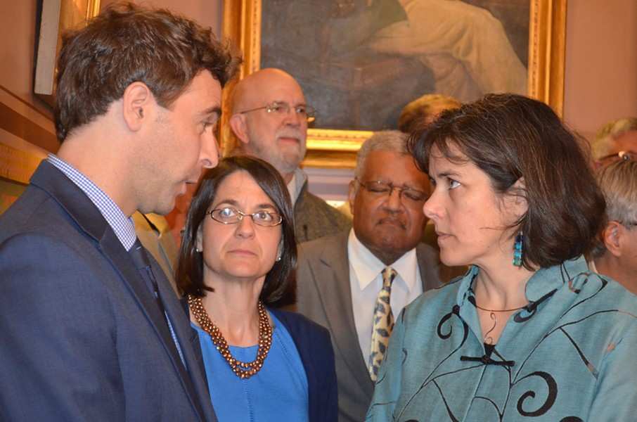 Senate President Pro Tempore Tim Ashe and House Speaker Mitzi Johnson confer before Wednesday's press conference as Senate Majority Leader Becca Balint (center) looks on. - ALICIA FREESE
