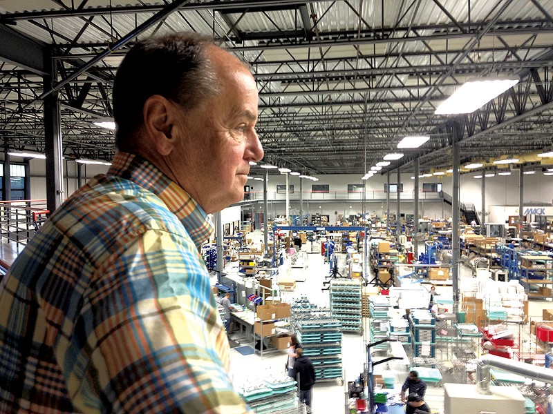 Jeff Somple, president of Mack Molding, looking out over the plant floor - MOLLY WALSH