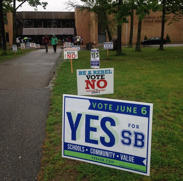 Signs outside Frederick H. Tuttle Middle School in South Burlington Tuesday - MOLLY WALSH