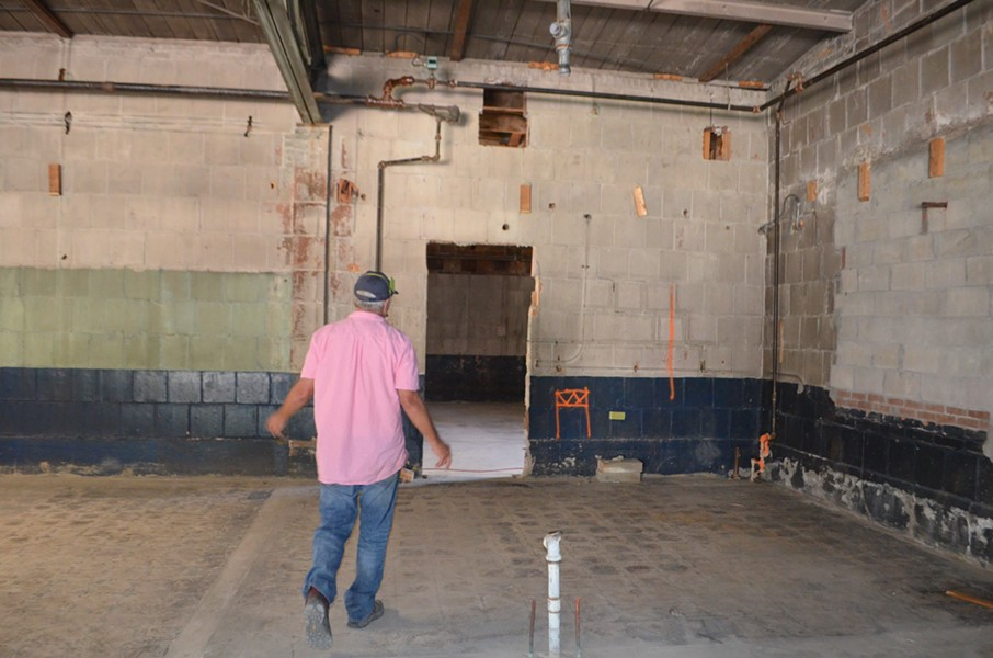 John Koerner shows off the inside of the building. - SASHA GOLDSTEIN