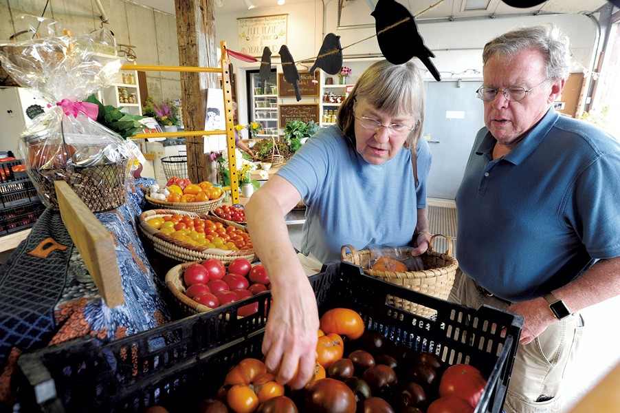 Dorrie and Keith Ellsworth of Northfield shopping for tomatoes at Green Mountain Girls farm store - JEB WALLACE-BRODEUR