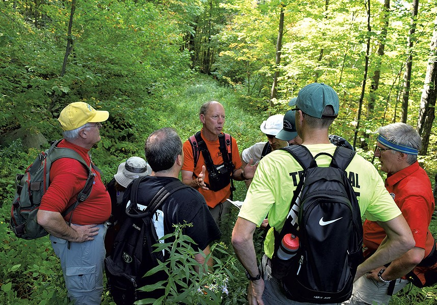Neil Van Dyke talking to rescue squad members - TERRI HALLENBECK