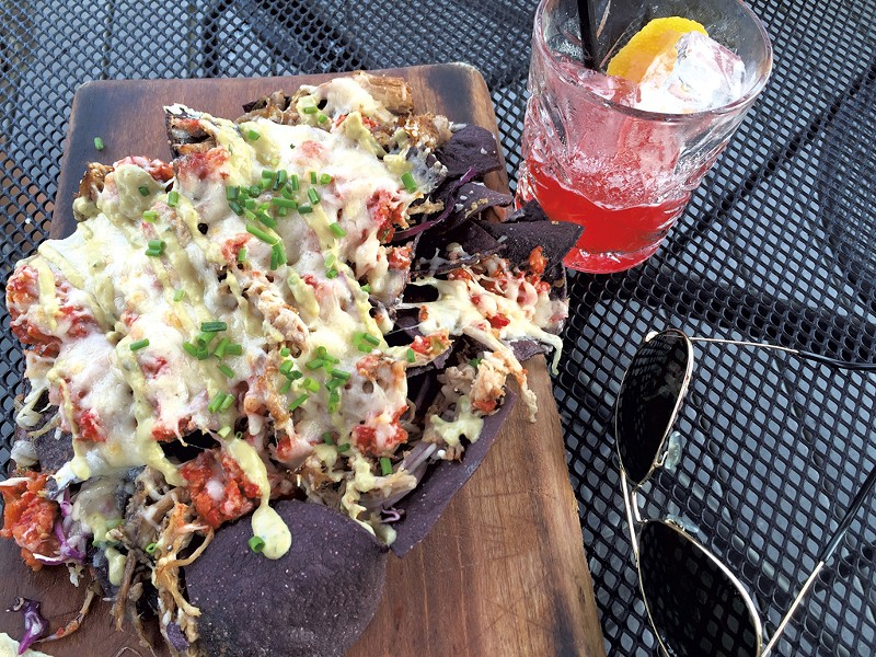 Nachos and a drink - SALLY POLLAK