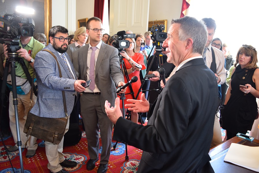 Neal Goswami, left, and Kyle Midura covering a gubernatorial press conference. - TERRI HALLENBECK