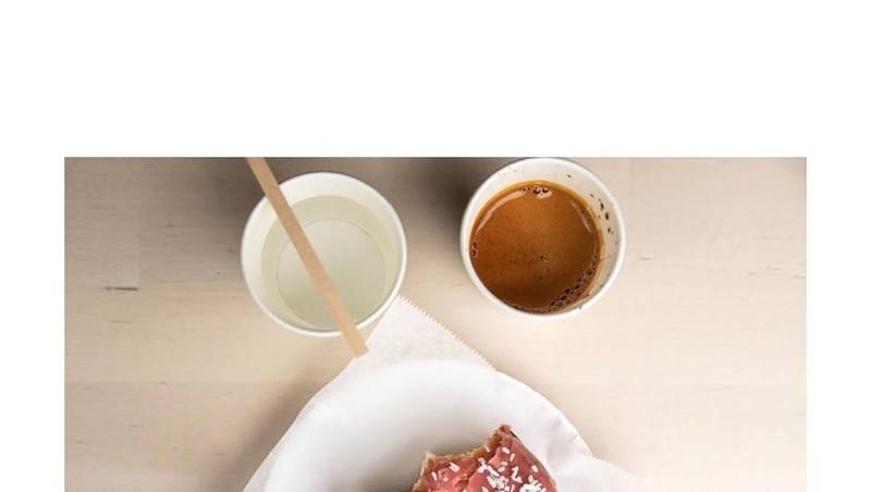 Sourdough doughnut and coffee at Abracadabra Coffee