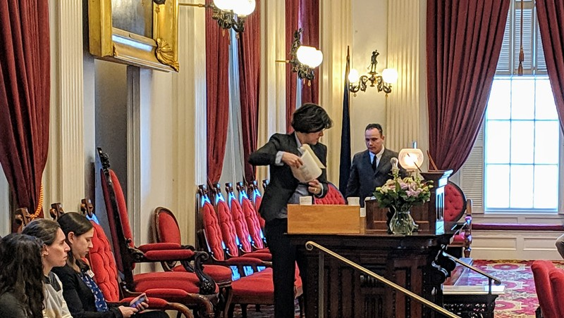 House Speaker Mitzi Johnson (D-South Hero) cleaned off her podium after accidentally smashing a glass lampshade with a gavel.