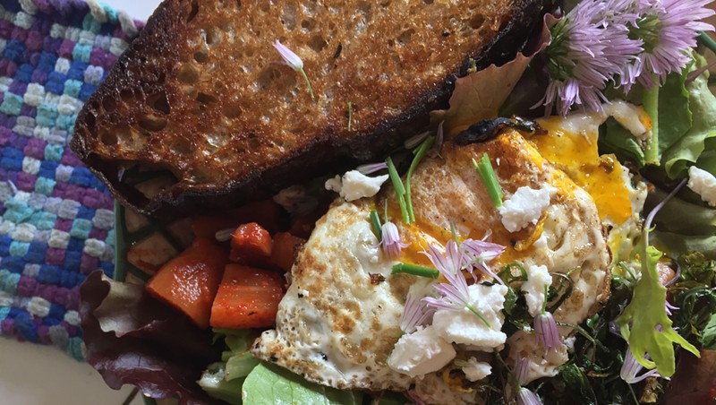 Breakfast salad with egg, radish kimchi, sautéed radishes and greens, and butter-grilled bread