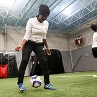The Golden Blazers Girls Soccer Team Sahro Luhizo dribbling a ball James Buck