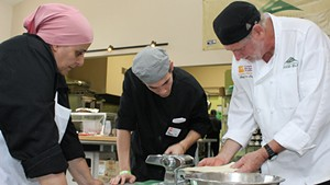 Community Kitchen Academy chef Jim Logan (right) with students