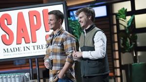 """Nikita Salmon (left) and Chas Smith on the set of """"Shark Tank"""""""