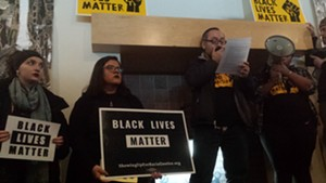 John Mejia addressing the crowd at the Davis Center