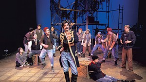 Christian DeKett (center) as Black Stache with the cast of Peter and the Starcatcher