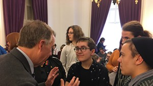 Gov. Phil Scott speaking with Alex Escaja-Heiss of South Burlington and Nathan DeGroot of Worcester