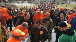 Gun-rights supporters making donations to the Federation of Vermont Sportsmen's Club for a lawsuit against S.55 while others wait in long lines to receive free 30-round magazines.