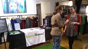Heady Vermont CEO Monica Donovan, right, chats with an attendee.