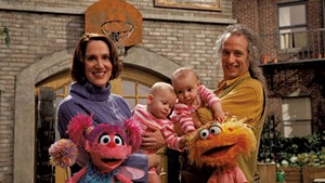 Annie Evans and Martin P. Robinson with their twins and Muppets
